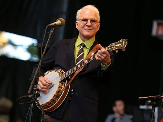 In this Oct. 20, 2012, file photo, Steve Martin performs at the Shoreline Amphitheatre in Mountain View, Calif.