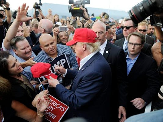 Republican presidential candidate Donald Trump, center, greets supporter after speaking at a campaign event aboard the USS Iowa battleship in Los Angeles Tuesday, Sept. 15, 2015.