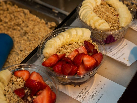 Various types of bowls prepared for customers almost ready for pick up. Abby Taylor and Robert Guiliani came up with an idea to start a business selling acai berries and other health food at the Jersey Shore. It turned into Playa Bowls, and they are expanding fast.