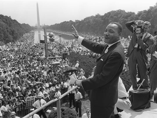 The civil rights leader Martin Luther King waves to supporters Aug. 28, 1963 on the Mall in Washington D.C.
