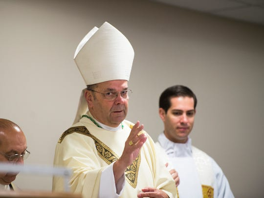 "Bishop Robert Cunningham, of the Syracuse Catholic Diocese, leads a ""Year of Mercy"" Mass Thursday at Catholic Charities of Broome County in Binghamton."