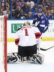 Apr 12, 2018; Tampa, FL, USA; Tampa Bay Lightning left wing Alex Killorn (17) shoots as New Jersey Devils goaltender Keith Kinkaid (1) makes a save during the first period of game one of the first round of the 2018 Stanley Cup Playoffs at Amalie Arena.