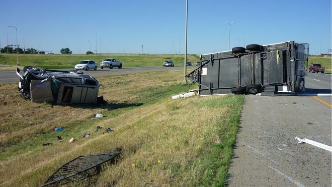 A Sioux City resident rolled his vehicle that was towing a camper while travelinig southbound on I-29 on Tuesday morning.