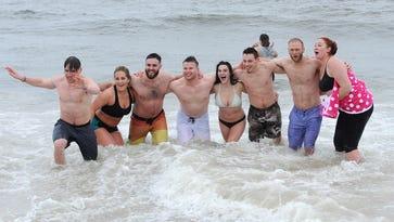 Polar Bear Plunge draws thousands to beaches