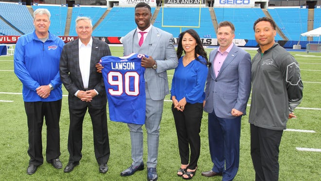 Buffalo Bills first round NFL football draft pick Shaq Lawson (90) poses for photos following a media conference at Ralph Wilson Stadium in Orchard Park, on April 29, 2016.