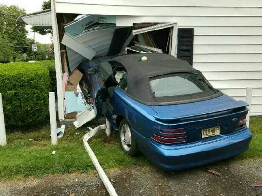 A 1994 Mustang crashed into a house on Ridge Road in South Brunswick on May 22 after the driver lost control.