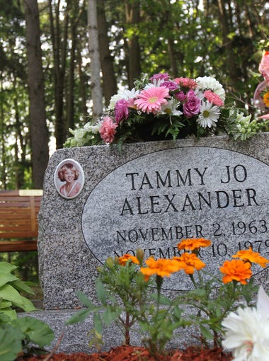 The new grave stone with Tammy Jo Alexander's name is etched on the back side of the old grave stone.  It is now facing out  at Greenmount Cemetery in Dansville on June 10, 2015.  A bench was also added nearby.