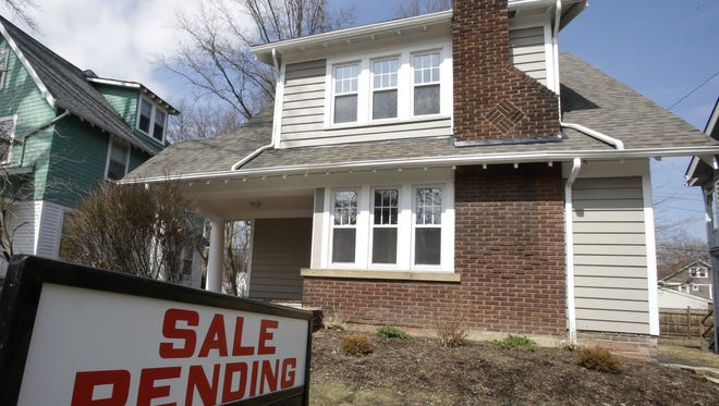 This March 2014 file photo shows a home for sale in Cleveland Heights, Ohio.  (AP Photo/Tony Dejak, File)