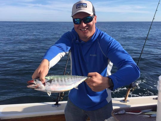 Spencer Comtois with a bonito he caught on the Reel