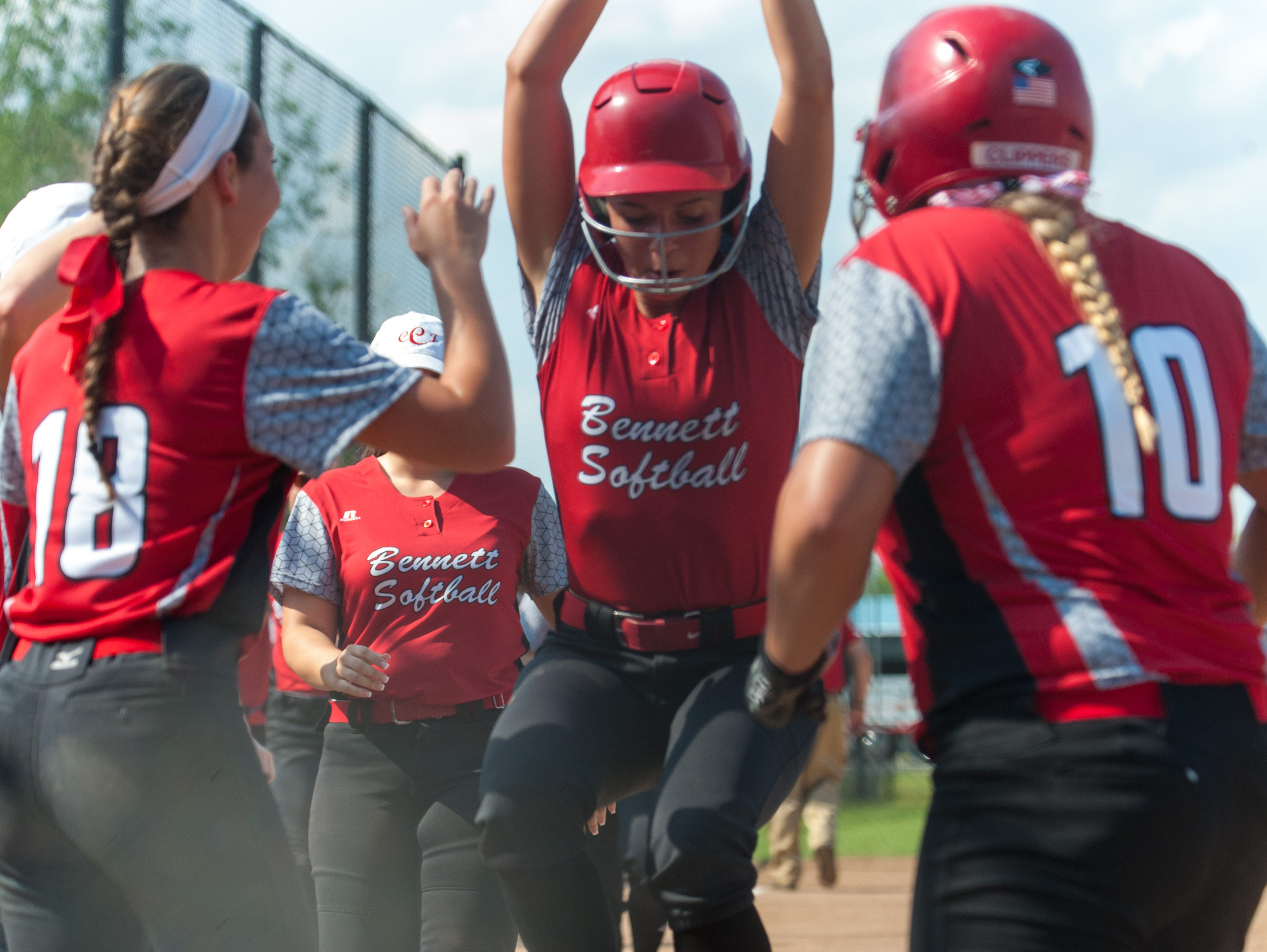 Bennett pitcher Kasey Donalds (7) is engulfed in Clippers after hitting a game-opening home run against Huntingtown in the MPSSAA playoffs on Tuesday afternoon.