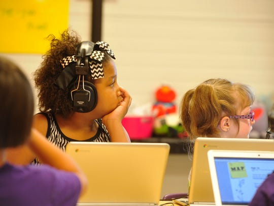 In this file photo, Adrion Floyd, left, and Andrea Reynolds, right, listen to instructions at Rocketship Nashville Northeast Elementary on May 19, 2015.