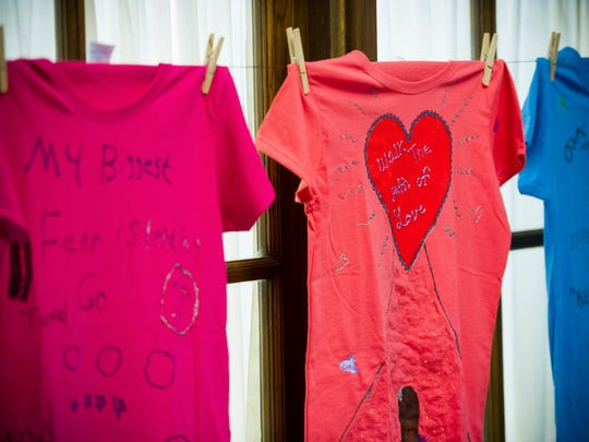 Shirts decorated by domestic violence survivors for the Clothesline Project in the Evansville YWCA, Tuesday, Oct. 18, 2016. The Clothesline Project displays shirts decorated by domestic violence survivors for domestic violence awareness month.
