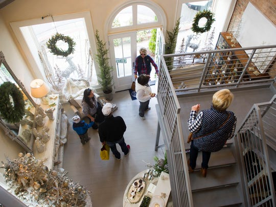 Patrons move through The Barefoot Cottage during Small Business Saturday in Newburgh, Nov, 26, 2016. Independent businesses throughout the country take part in the annual event.