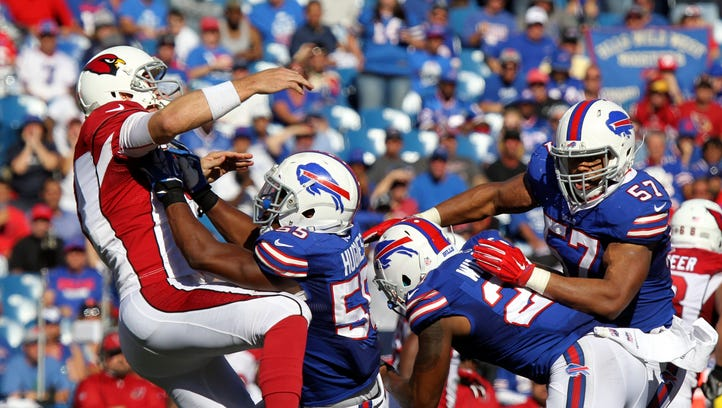 Arizona Cardinals quarterback Carson Palmer (3) is hit by Buffalo Bills outside linebacker Jerry Hughes (55) during the second half of an NFL football game on Sunday, Sept. 25, 2016, in Orchard Park, N.Y.