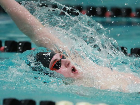Brown Deer's Ben Hayes swims backstroke during the 200 Yard Individual Medley. Hayes won the event with the time of 1:52.43.