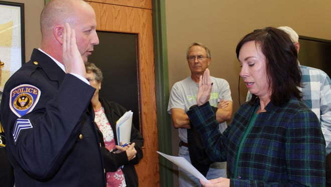 Doug Lanier was given the oath of office by Fairfield Township Trustee Susan Berding after being promoted to captain/assistant chief of the Fairfield Township Police Department.