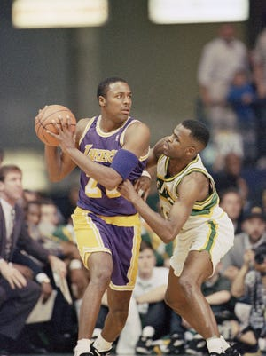 """Recognize the guy on defense? Nate McMillan, then a Seattle Supersonics point guard, was a defense-first player. And that's where he wants the team he coaches. """"Every day we're pounding the same thing. We want two-way players,"""" says McMillan. """"You're not going to play on this team just focused on the offensive end of the floor."""" In 1995, McMillan made Cedric Ceballos of the Lakers work to keep the ball away from him."""