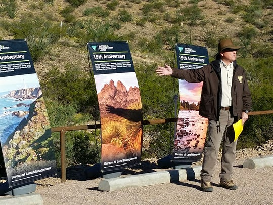 Bill Childress, regional manager for the U.S. Bureau of Land Management, speaks Saturday the 15th anniversary of the agency's National Landscape Conservation System at Prehistoric Trackways National Monumen. The unit manages lands like the monument.