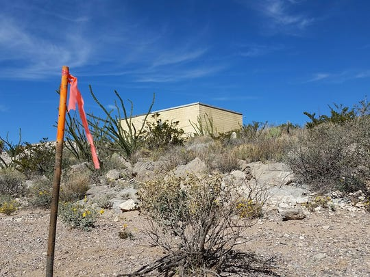 "Orange flagging is seen Nov. 11 near a structure called the AT&T Building on top of Tortugas ""A"" Mountain southeast of Las Cruces. Flags were posted to mark the boundary areas for a contractor that will be tearing down the building as early as Wednesday, New Mexico State University officials said."