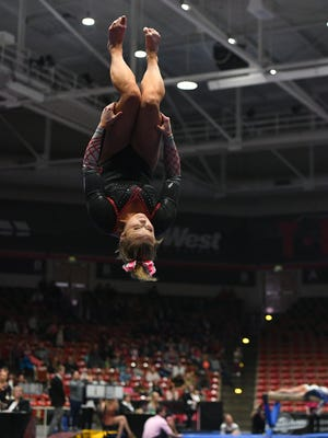 The Southern Utah University gymnastics team compete against Utah State University at the America First Center Friday, February 12, 2018.