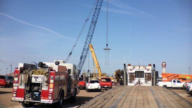 Phoenix Fire Department rescue crews were at the scene of a toppled drilling rig at Sky Harbor Airport May 18, 2018. One man was believed to be trapped in a hole.