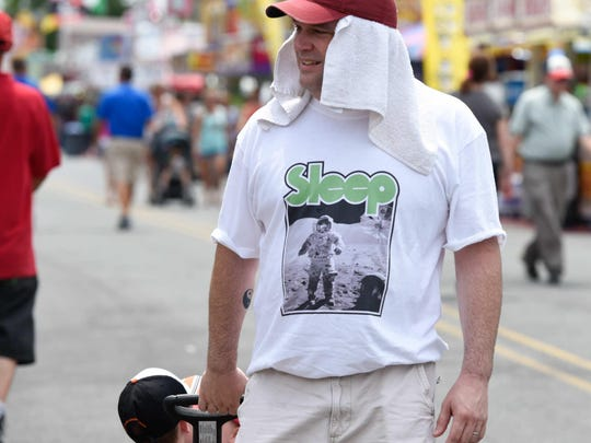 Rob Harris of Smyrna keeps cool with a towel under his hat at the Delaware State Fair in Harrington.
