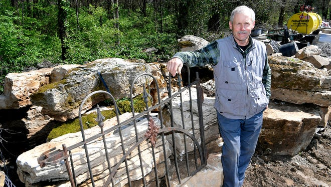 Franklin landscaper Bill Hewitt plans to create a prayer wall outside of the Fourth Avenue Church of Christ in downtown Franklin this summer. Hewitt has collected rocks and a gate to be use for the prayer wall.