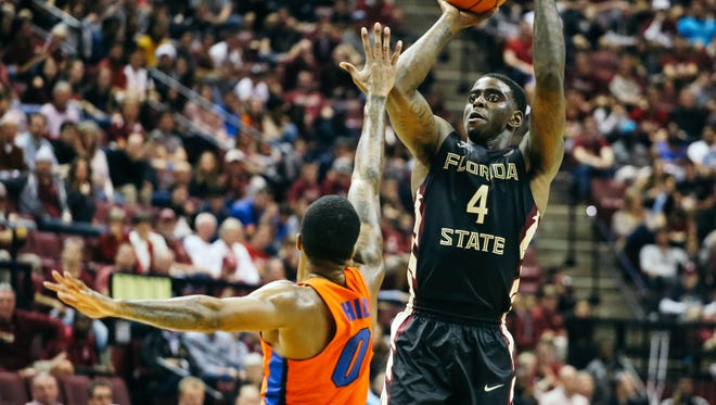 Dwayne Bacon (4) shoots the ball during the second half against the Florida Gators on Sunday, December 11, 2016. The Seminoles defeated the Gators 83-78.