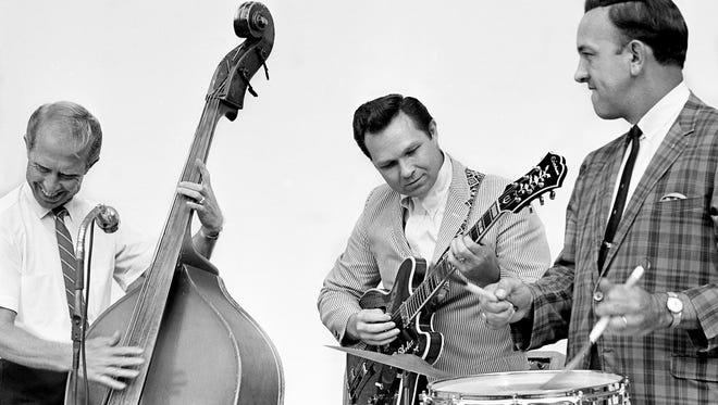 Leon Rhodes (center), guitarist with Ernest Tubb's Texas Troubadours, 85.