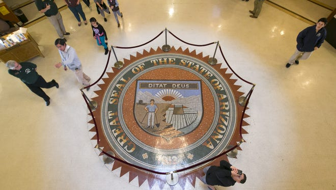 The Arizona state seal is seen in the rotunda room in the Arizona state Capitol in Phoenix on Jan. 6, 2017. According to state records acquired by The Arizona RepublicFriday,the lobbyists did not file the 2017 second-quarter expenditure reports required under state law.