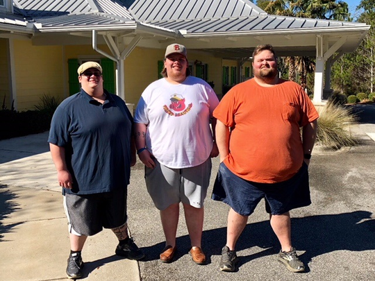 Gary, Daniel, and Kelly standing outside the gym getting ready to work out.