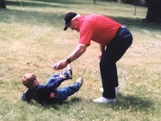 Robert Jewell plays football with grandson Josey in