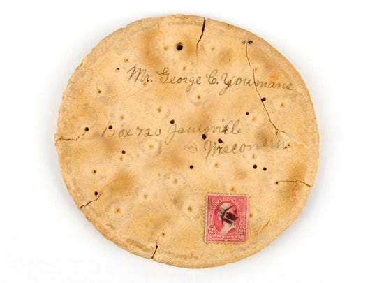 This piece of hardtack was mailed home to Janesville from Camp Cuba Libre in Jacksonville, Fla. during the Spanish American War by a soldier who wrote his father's name, George G. Youmans, and address before affixing a 2 cent stamp. It was later donated to the Wisconsin Veterans Museum. Noted for its bland taste and sturdiness, hardtack was made from flour, water and salt and given to soldiers from the Civil War through the Spanish American War.