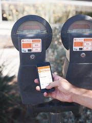 The app allows users to pay for meters remotely. park