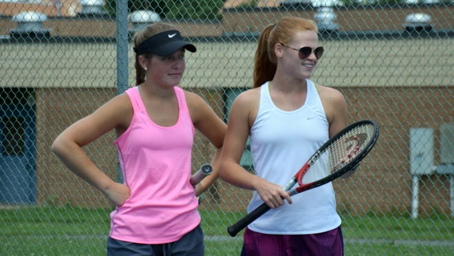 Riverheads' Grace Staton, left, and Blake Bartley, right, wait for Ali Keister of Fort Defiance and Emma Nesselrodt of Turner Ashby to return to their practice match at Stewart Middle School in Fort Defiance, Va., on Tuesday, June 6, 2017. Staton and Bartley play in the VHSL Group 1A state semifinals in Radford on Friday.