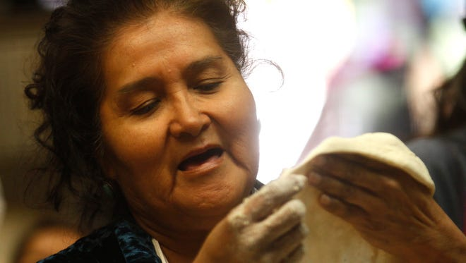 Beclabito Chapter resident Patricia Whitehorse demonstrates how to make frybread dough on Monday the Native American Center at San Juan College in Farmington.