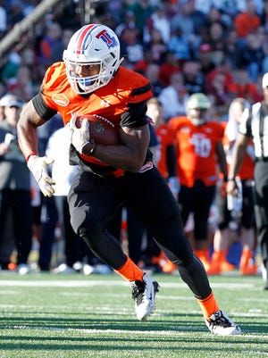Former Louisiana Tech running back Kenneth Dixon carries the ball in last month's Senior Bowl. Dixon is one of three Bulldogs to receive an invite to the NFL Combine later this month.
