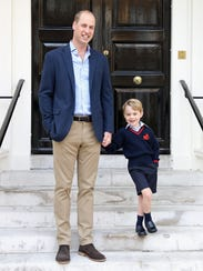 Prince William with son Prince George at Kensington