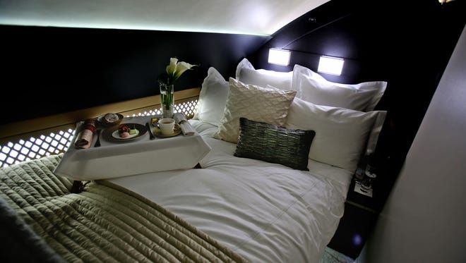 """This file photo taken Sunday, May 4, 2014, shows the 125-square-foot (11.61-square-meter) area that includes a """"living room"""" partitioned off from the first-class aisle, leather seating, a chilled mini-bar and a 32-inch flat-screen TV, at a training facility in Abu Dhabi, United Arab Emirates. The area was created as a mock-up suite to be built in Etihad Airways airplanes."""