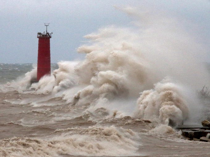 Strong winds whipped waves against the Sheboygan north