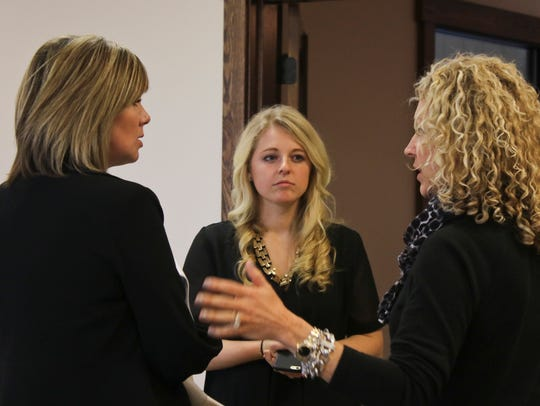 From left, Katie Gambill of 5 Star Media Group talks