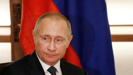 Russian President Vladimir Putin is seen in Nagato, western Japan, Thursday, Dec. 15, 2016. The Obama administration suggested Thursday that Putin personally authorized the hacking of Democratic officials' email accounts in the run-up to the presidential election, which intelligence agencies believe was designed to help Donald Trump prevail. The White House also leveled an astounding attack on Trump himself, saying he must have known of Russia's interference.