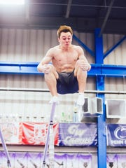 Michael Moran of Morristown dismounts from the parallel bars during practice.