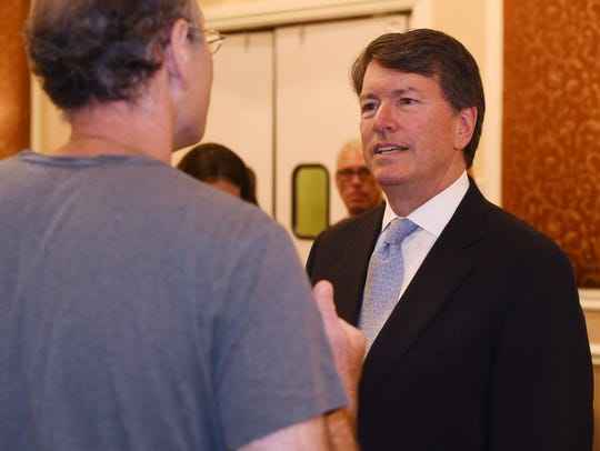 Rep. John Faso, right, speaks with a member of the