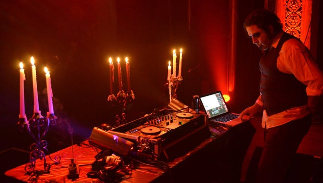 Eloy Alvarado spins some tunes during last year's Club Dedo Halloween Ball.