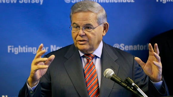 Sen. Robert Menendez addresses a gathering in Newark, N.J. on Friday, Nov. 14, 2014 demanding that the Federal Emergency Management Administration investigate allegations that insurers are manipulating flood damage claims to shortchange Sandy victims. A federal judge in New York recently found evidence that flood insurance companies have had damage assessors alter reports so they could pay less to policyholders. (APA Photo/Mel Evans)
