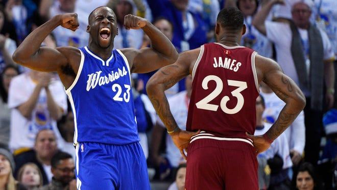 Warriors forward Draymond Green reacts during the first half against the Cavaliers.