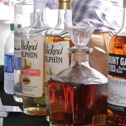 People make their way through the Pensacola Beach Rum
