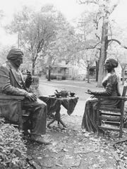"""DO NOT PUBLISH THIS PHOTO. WE DO NOT HAVE RIGHTS. Aameanah King's photography is part of an urban project in which she photographed the sculpture in Susan B. Anthony Square Park of Frederick Douglas and Susan B. Anthony called """"Let's Have Tea,"""" by Rochester sculptor Pepsy Kettavong."""
