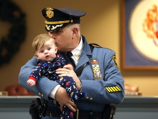 New Morris County Sheriff James Gannon gives a kiss to his 4-month-old grandson Luca after he was sworn in by Lt. Gov. Kim Guadagno at the Morris County Administration and Records building in Morristown. January 6, 2017, Morristown, NJ.